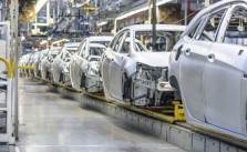 An Image Showing The Production Line In Auto Manufacturing Industry.